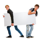 Two teenagers pulling blank billboard. Isolated on white