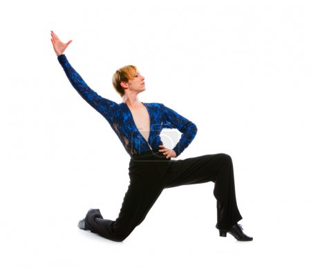Ballroom male dancer posing on one knee on white background