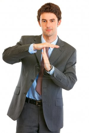 Confident young businessman time out crossed arms