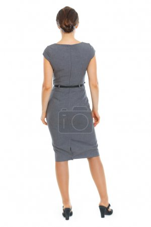 Business woman standing back to camera