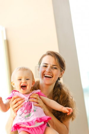 Portrait of smiling mother and baby