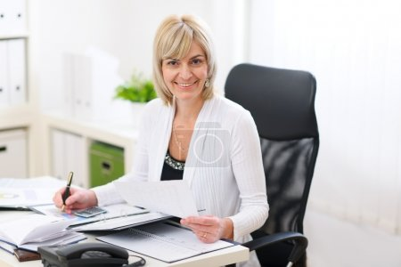 Happy business woman working at office
