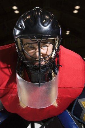 Woman hockey goalie.