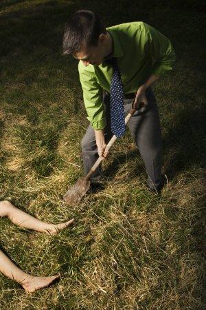 Businessman Burying Dead Body