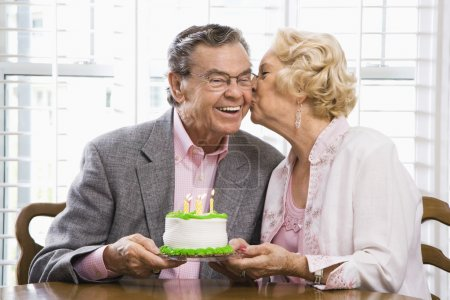 Mature couple with cake.