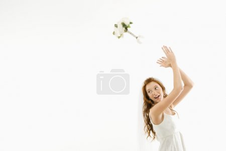 Bride tossing bouquet.