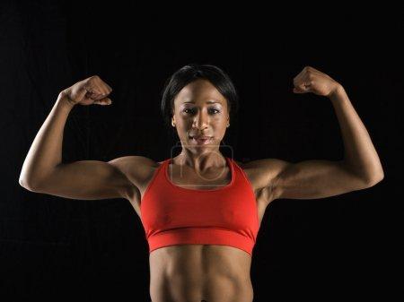 Woman flexing muscles.