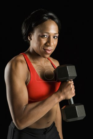 Woman holding dumbbell.