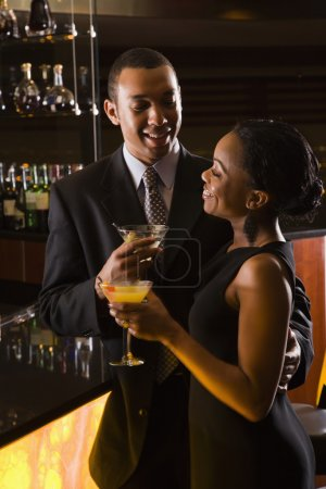 African-American couple having drinks at the bar.