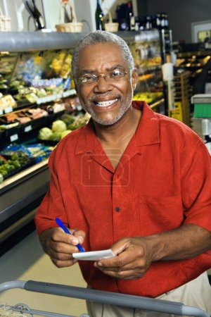 Man with grocery list.