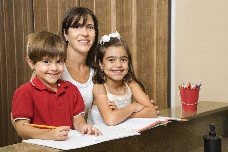 Mom and kids with homework.