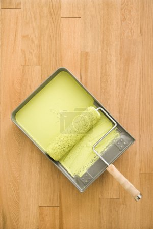 Paint roller in tray.