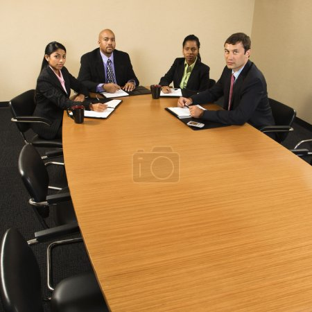 Businesspeople in meeting.