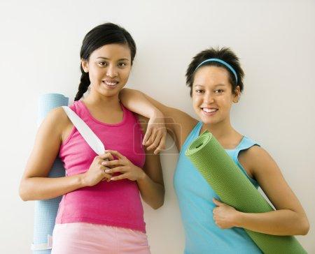 Women with yoga mats