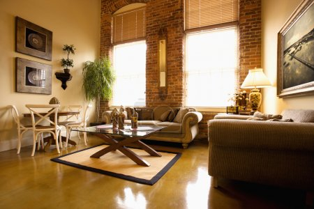 Photo for Interior of furnished living room with large windows and brick wall. Horizontal shot. - Royalty Free Image