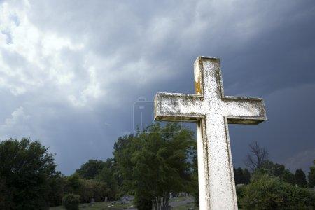 Cross against stormy sky.
