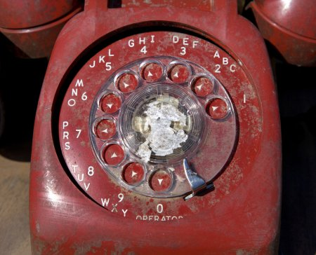 Old red rotary phone.