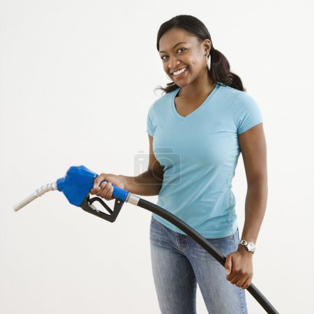 Woman with gas nozzle.