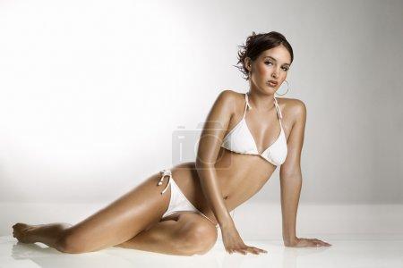 Woman in bathing suit.