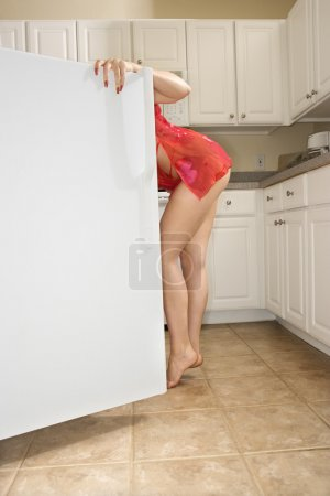Woman in refrigerator.