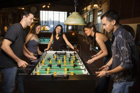 Group of Playing Foosball