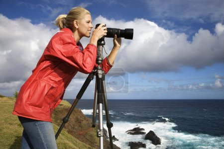 Woman taking pictures.