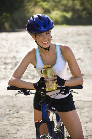 Young woman biking.