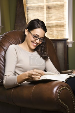 Woman reading and smiling.