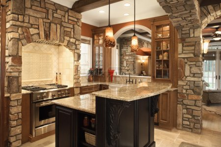 Photo for Upscale kitchen interior with stone accents and wood beam ceiling. Horizontal shot. - Royalty Free Image