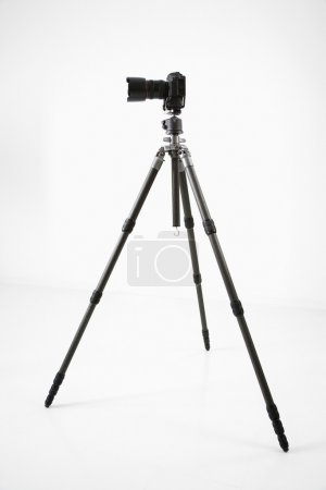 Photo for Studio shot of camera and tripod. - Royalty Free Image