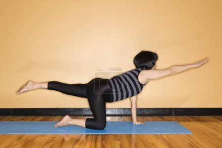 Woman Stretching in Yoga Pose