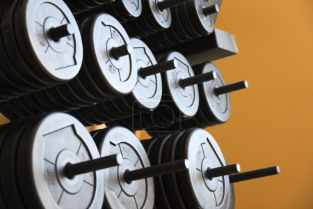 Stacked barbells with weights.