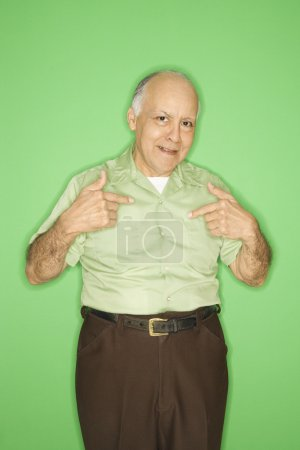 Photo for Caucasian mature adult male pointing to himself. - Royalty Free Image