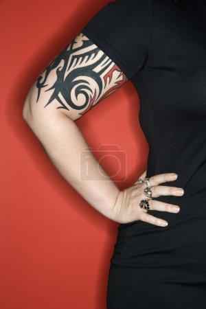 Tattooed woman arm.