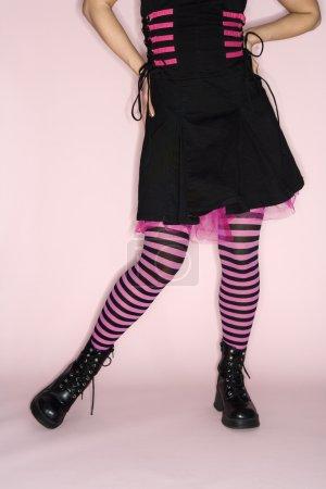 Woman wearing striped leggings.
