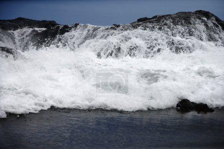 Waves crashing.