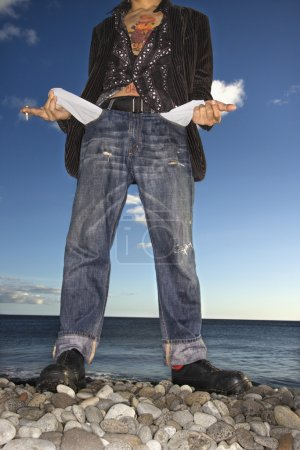 Young Man at Beach with Empty Pockets