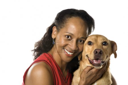 Photo for African American prime adult female with dog. - Royalty Free Image