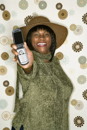 Woman holding out cellphone.