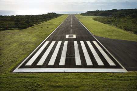 Aerial view of paved airplane runway on Maui, Hawaii.