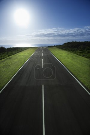 Photo for Airplane runway with Pacific ocean in background. - Royalty Free Image