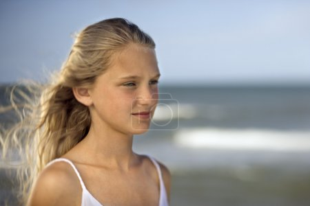 Girl on beach with ocean.
