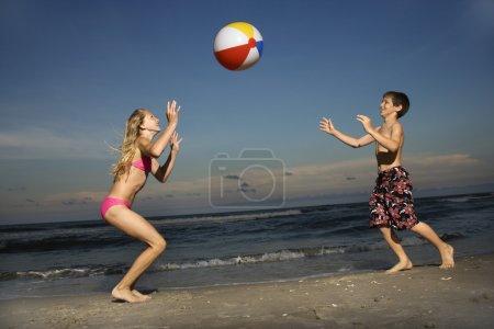 Boy and girl on beach.