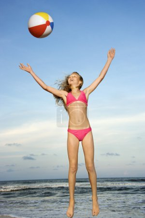 Girl playing with beachball.