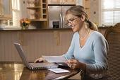 Woman on computer.