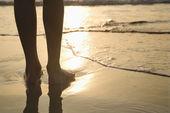 Feet in sand.