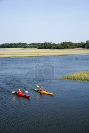 Teen boys kayaking.