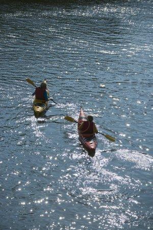 Two boys kayaking.