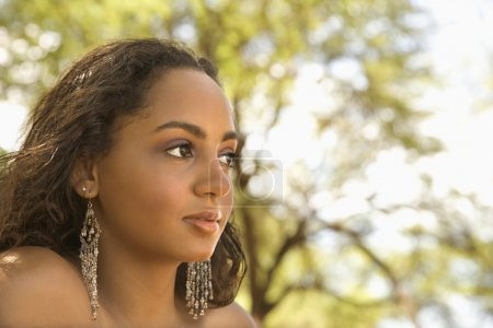 Photo for Young-adult African American woman looking to the side. - Royalty Free Image