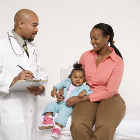 Child with pediatrician.